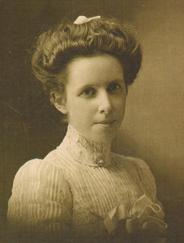 old timey photo with white woman in early 1900s style hair and clothes